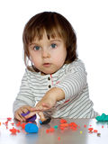 Portrait little girl is playing with coloful dough Royalty Free Stock Images