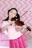 Little girl playing a music with a violin Royalty Free Stock Photos