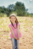 Portrait of little girl playing with sand in park Royalty Free Stock Image