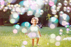 Portrait of a little girl playing the soap bubbles Royalty Free Stock Photo