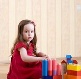 Portrait of a little girl playing with toys Stock Image