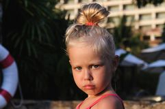Portrait of a little girl by the pool stock image
