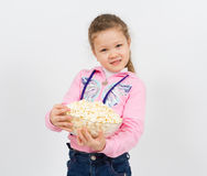Portrait of a little girl with popcorn Stock Image