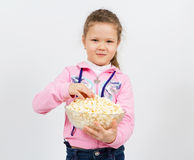 Portrait of a little girl with popcorn Stock Images