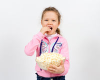 Portrait of a little girl with popcorn Royalty Free Stock Photos