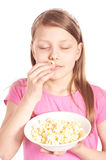 Portrait of a little girl with popcorn on white Stock Photos