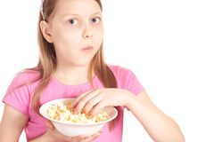 Portrait of a little girl with popcorn on white Stock Photography