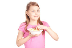Portrait of a little girl with popcorn on white Stock Images
