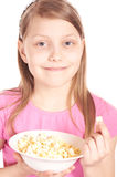 Portrait of a little girl with popcorn on white Stock Photo