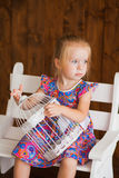 Portrait of a little girl in purple dress Stock Images