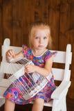 Portrait of a little girl in purple dress Stock Image