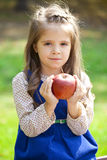 Portrait of a little girl with red large apple Royalty Free Stock Photography