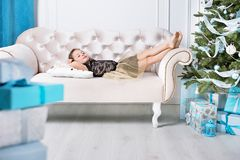 Portrait of a little girl relaxing on a modern sofa royalty free stock photo