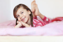 Girl in the bed Stock Photos
