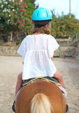 Portrait of little girl riding pony. Royalty Free Stock Photos