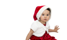 Portrait of little girl in Santa hat. Isolated stock image