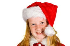 Portrait of little girl in santa's hat Royalty Free Stock Images