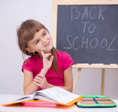 Portrait of a little girl in school. Portrait of a cute cheerful little girl in school Stock Image