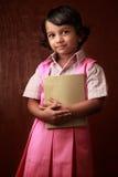 Portrait of a little girl in school uniform Stock Photo