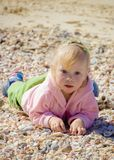 Portrait of little girl on the sea Stock Photos