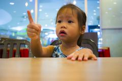 Portrait little girl showing hand sign stock photo