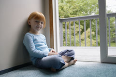 Portrait Of Little Girl Sitting By Balcony Stock Photography