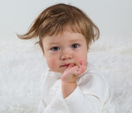 Portrait of a little girl, that is sitting on the bed Royalty Free Stock Image