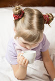 Portrait of a little girl sitting in a bed Royalty Free Stock Image