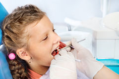Grl in a dentist's chair Stock Photography