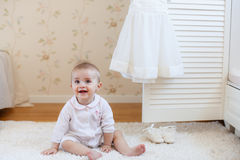 Portrait of a little girl sitting on the floor Royalty Free Stock Photo