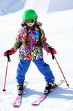 Portrait of little girl skier in sports suit Stock Photo