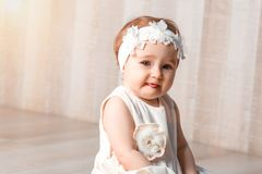 Portrait of little girl smiles and shows the language royalty free stock photo