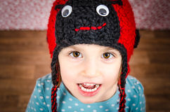 Portrait of little girl smiling and being happy. Child is wearin Royalty Free Stock Photography