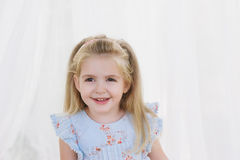 Portrait of a little girl smiling blonde Royalty Free Stock Photo