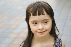 Portrait of little girl smiling in the city stock photography