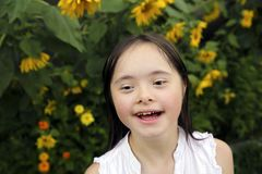 Portrait of little girl smiling in the garden royalty free stock photo