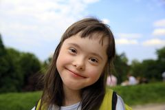 Portrait of little girl smiling in the park stock photography