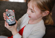 Portrait little girl with a snow globe. Royalty Free Stock Photo