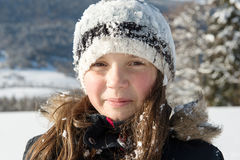 Portrait of a little girl in the snow Stock Images