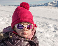 Portrait of a little girl in the snow stock photos