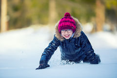 Portrait of a little girl in the snow. Winter joy of a child of a lot of snow Stock Image