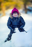 Portrait of a little girl in the snow. Winter joy of a child of a lot of snow Stock Photos