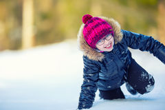 Portrait of a little girl in the snow. Winter joy of a child of a lot of snow Stock Photo