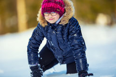 Portrait of a little girl in the snow. Winter joy of a child of a lot of snow Royalty Free Stock Photo