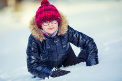 Portrait of a little girl in the snow. Winter joy of a child of a lot of snow Royalty Free Stock Images