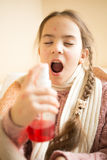 Portrait of little girl with sore throat using spray. Closeup portrait of little girl with sore throat using spray Royalty Free Stock Image