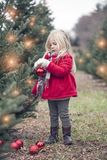 Portrait of little girl standing with bauble in hands royalty free stock photography
