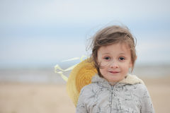 Portrait of little girl standing on a sandy sea shore Stock Photography