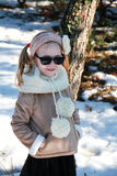 Portrait of little girl standing in winter park with hands in his pockets Stock Photography