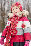 Portrait of little girl standing in winter park Stock Photo